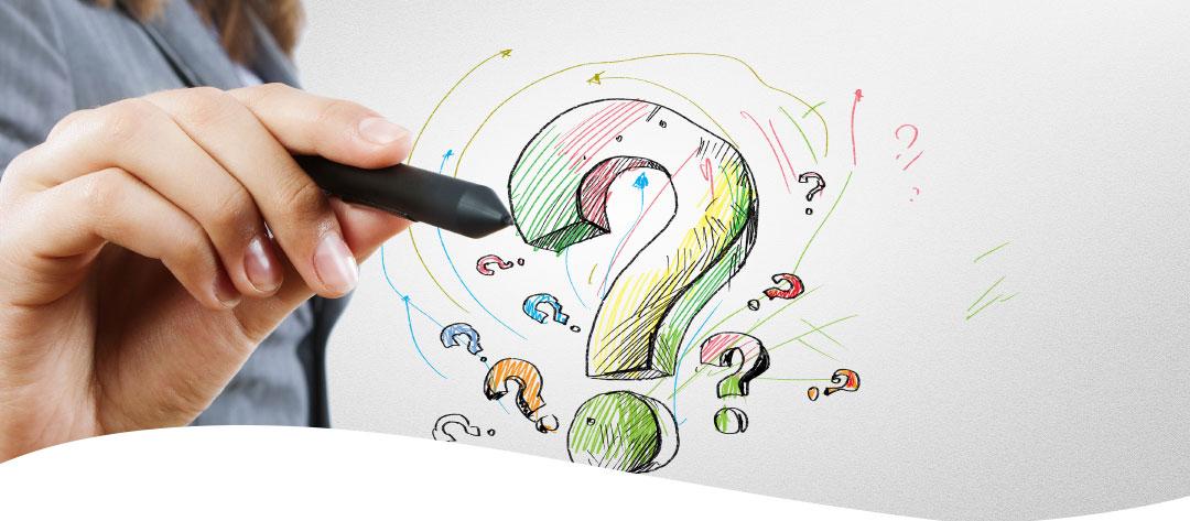 Abbildung für FAQ - Frauenhände einen Stift haltend, auf eine Glasscheibe ein Fragezeichen zeichnend